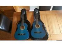 2 children's guitars with Neville brothers cases