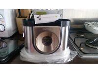SIMPLEHUMAN stainless steel utensil holder.