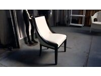 Bedroom chair - black and white in very good condition. Delivery is available f required.