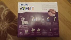 New breast pump kit and bottles