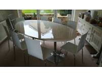 Danetti dining room table and eight chairs