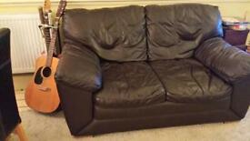 2 xTwo seater brown leather sofas