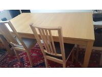 Extendable Ikea bjursta dining table and 6 chairs