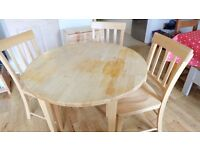 Marks and Spencer round table with collapsible sides and 3 matching chairs