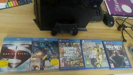Ps4 with 3 games 2 blue rays and vertical stand