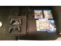 Ps4 boxed with with 2 controlers & games