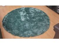 Teal green round rug