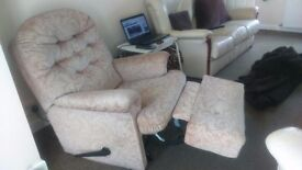 i have 2 manual recliner chairs also cream leather settee in background with one chair
