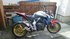 A showroom condition honda cb1000r extreme hrc only 459 miles you won't be disappointed.
