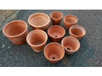 9 small terracotta pots