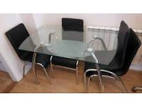 Glass dining table and 4 chairs collection only