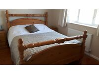 King size solid pine bed and mattress.