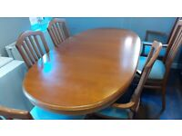 Very good condition. Extendable dining room table and chairs