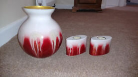 Lovely glass vase with two matching tea light candle holders.