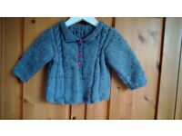 Hand knitted brand new babys coat