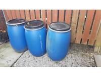 3 large plastic barrels