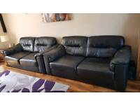 2 black leather sofa's one is in better condition than the other one as it has had more use