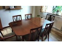 Mahogany extendable dining room table and 6 chairs
