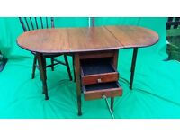 Solid wood foldable farmhouse table with drawers.