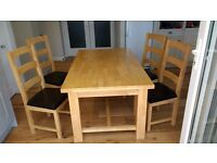 Oak extendable dining table plus four oak chairs