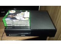 Xbox one 500GB with 4 games and rechargable battery pack.