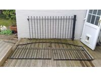 a pair of iron gates plus one panel for sale