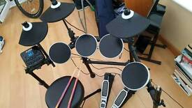 Alesis DM Lite digital drum kit, stool and 4 sticks.