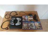 PS4 Slim 1TB Bundle black - 5 Games, Wireless Controller, spare skin & charging doc