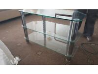 TV STAND , GLASS WITH SILVER PILLARS