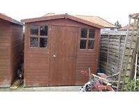 Garden Shed with two windows and a Door. Good condition. Size 8ft.x 7ft.