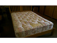 Wood frame double bed with sleepvendor mattress