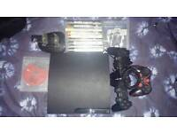 Ps3 slim 160gb 3 controllers, charging station, 13 games