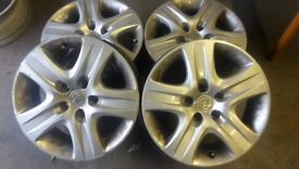 """4 x 16"""" original special vauxhall Rims.specially designed to look like alloys with the trims on top."""