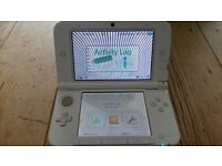 Nintendo 3DS XL in white Good used condition. Slight crack near the right bumper.