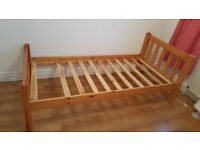 Single bed. Wooden.