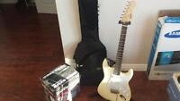 Electric guitar, stand, and amp starter kit