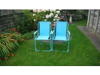 2 powder coated blue folding chairs.