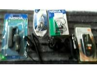 Various mobile phone accessories - 4 in car chargers 1 charger 2 hansfree kits