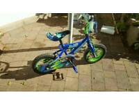Boys blue first bike