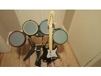 Rockband guitar and drumset