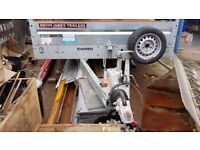 Trailer with twin axle, galvanised and with spare wheel.