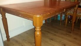 Unique wooden extendable solid old school table with 5 chairs and 1 armchair
