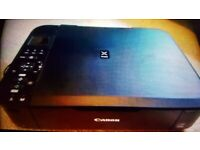 Cheap. Canon Wireless scanner printer. Can deliver locally.