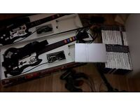Play Station 2, Games Bundle. Includes console, guitars x 2, buzzers x 4 and 26 games.