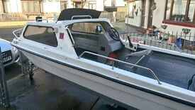 Seahog Hunter fishing boat on trailer with engines