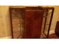 Solid wood antique display cabinet with glass sides.