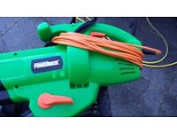 Powerbase 2600w Blower Vac with shoulder strap and collection bag.