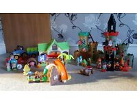 Happy land - 23 figures, 2 castles, pirate hut, 2 tractors and a farm house.