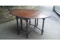 Antique Solid Oak Oval Drop Leaf Gateleg Dining Table with Barley Twist Legs, 5' L x 3 1/2' wide