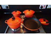 Set of Le Creuset Volcanic enamelled cast iron saucepans and frying pan with lids